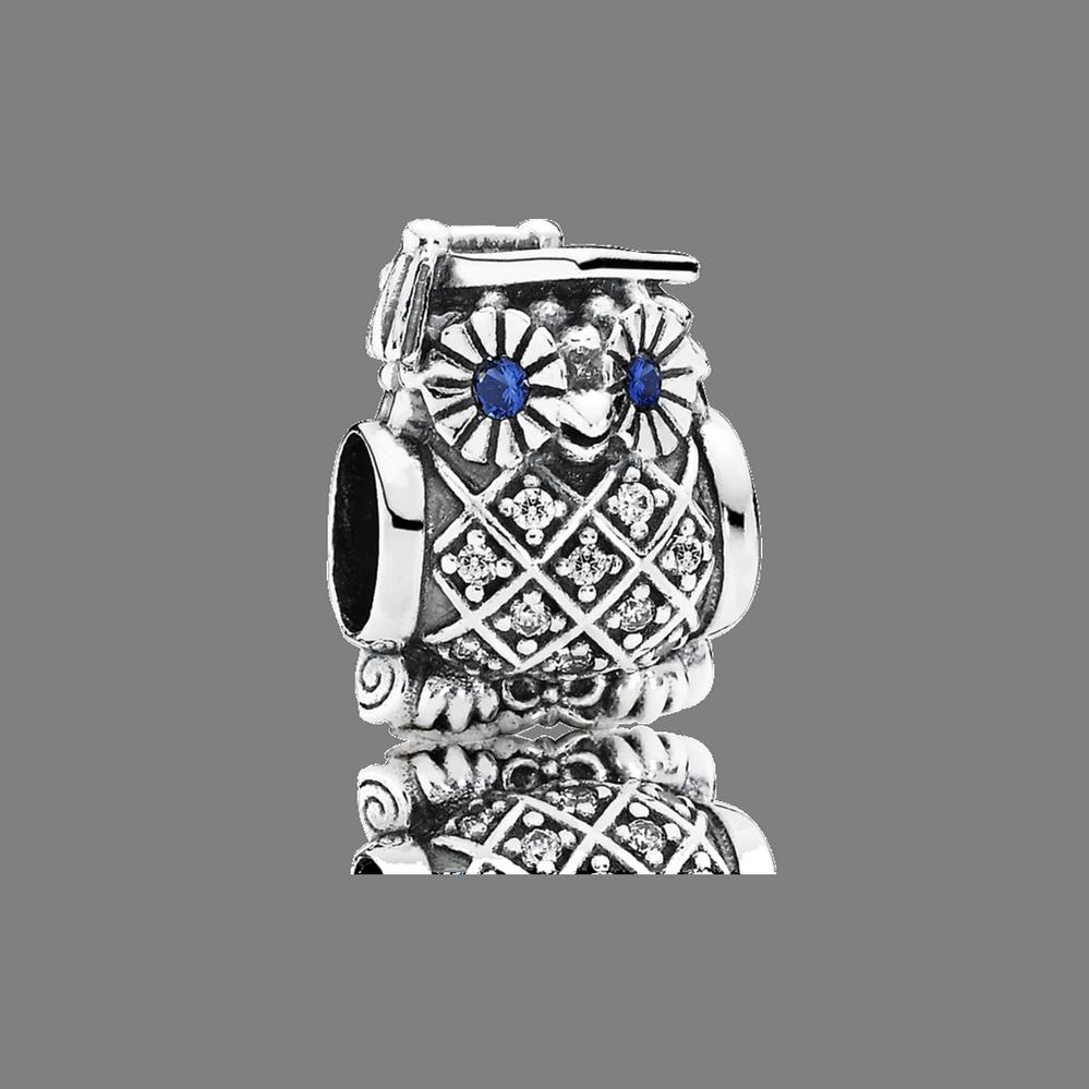 Hibou de cérémonie, cristal bleu de Suisse et cz incolore
